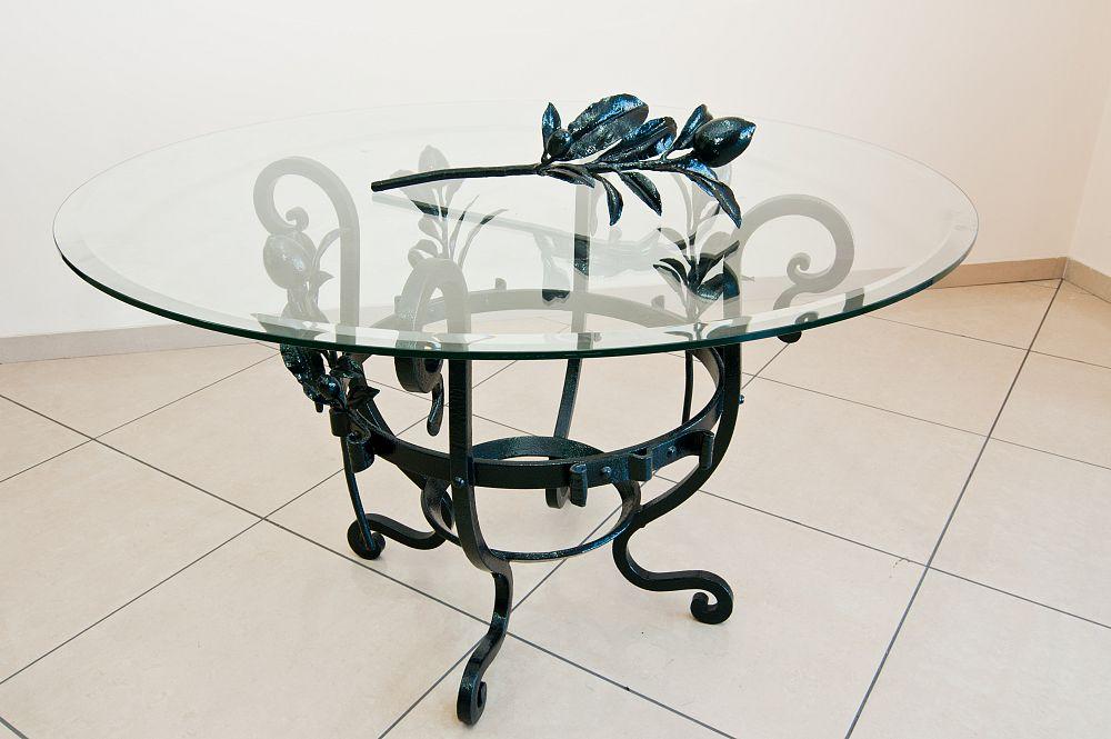 Tavolo in vetro con base in ferro battuto